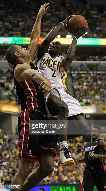 Darren Collison of the Indiana Pacers goes up for a shot against Shane Battier of the Miami Heat in Game Four of the Eastern Conference Semifinals in...