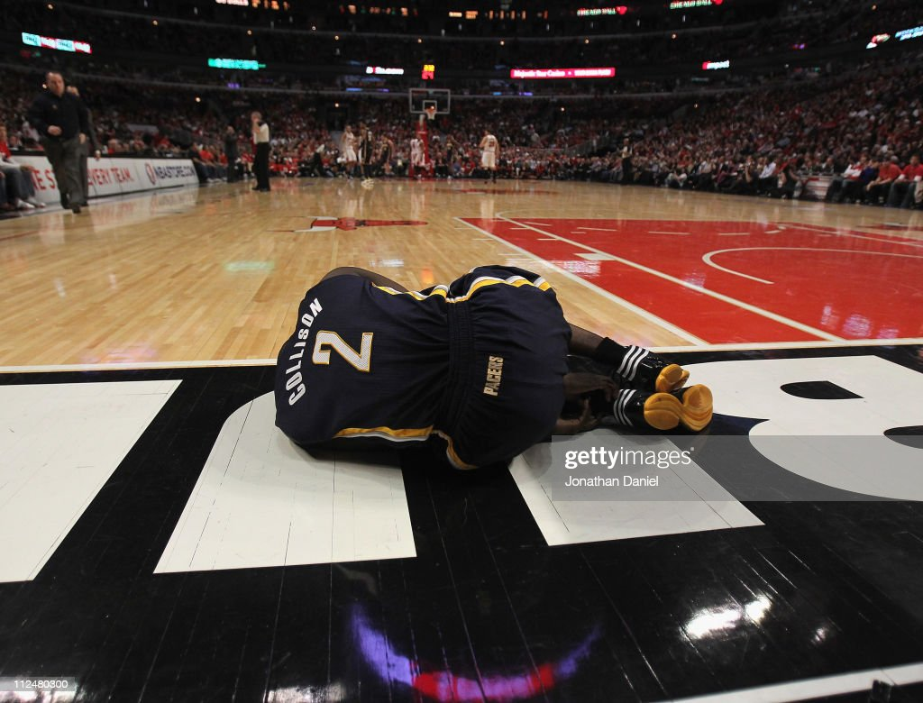 Darren Collison #2 of the Indiana Pacers lays on the floor after injuring his ankle shooting against the Chicago Bulls in Game Two of the Eastern Conference Quarterfinals in the 2011 NBA Playoffs at the United Center on April 18, 2011 in Chicago, Illinois.