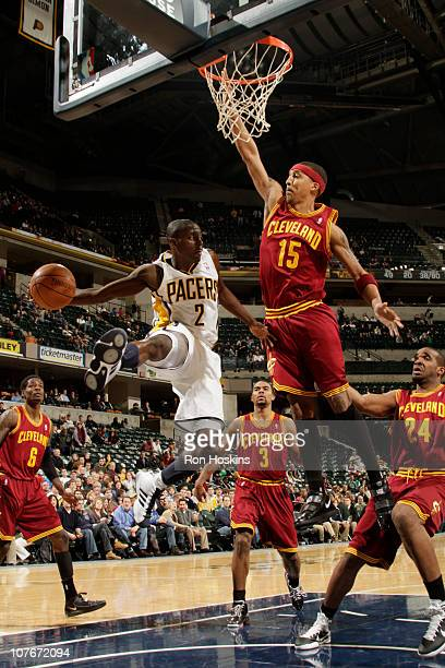 Darren Collison of the Indiana Pacers looks to pass the ball around Jamario Moon of the Cleveland Cavaliers on December 17 2010 at Conseco Fieldhouse...