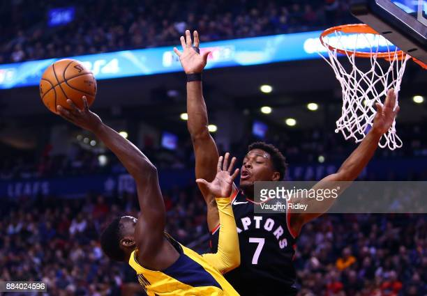 Darren Collison of the Indiana Pacers shoots the ball as Kyle Lowry of the Toronto Raptors defends during the first half of an NBA game at Air Canada...