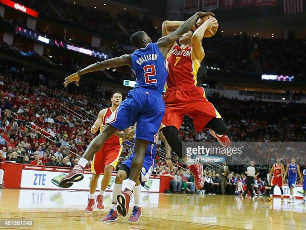 Darren Collison of the Los Angeles Clippers blocks a shot by Jeremy Lin of the Houston Rockets during the game at the Toyota Center on March 29 2014...