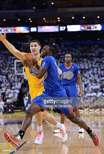 Darren Collison of the Los Angeles Clippers drives on Klay Thompson of the Golden State Warriors during the second quarter at ORACLE Arena on...