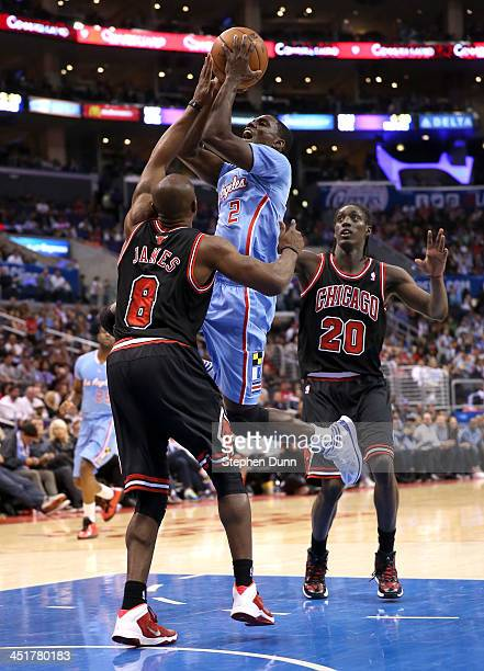 Darren Collison of the Los Angeles Clippers shoots over Mike James of the Chicago Bulls at Staples Center on November 24 2013 in Los Angeles...