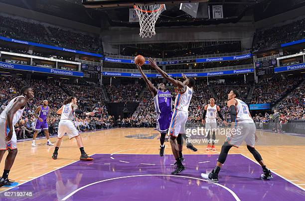 Darren Collison of the Sacramento Kings puts up a shot against Jerami Grant of the Oklahoma City Thunder on November 23 2016 at Golden 1 Center in...