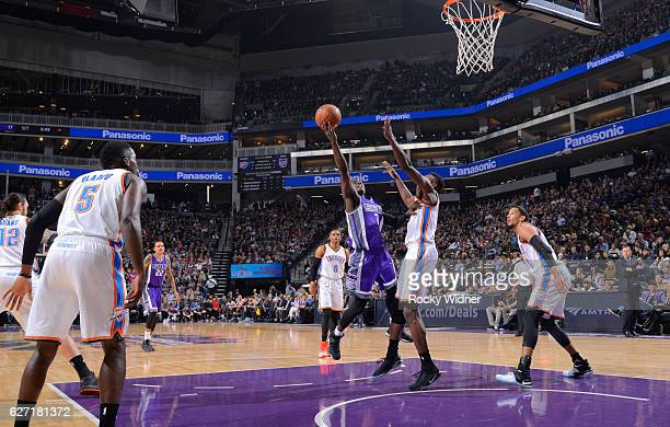 Darren Collison of the Sacramento Kings shoots a layup against Jerami Grant of the Oklahoma City Thunder on November 23 2016 at Golden 1 Center in...