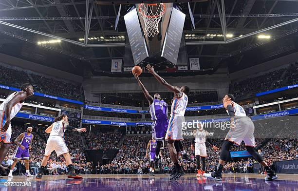 Darren Collison of the Sacramento Kings shoots a layup against Jerami Grant of the Oklahoma City Thunder on November 23, 2016 at Golden 1 Center in...