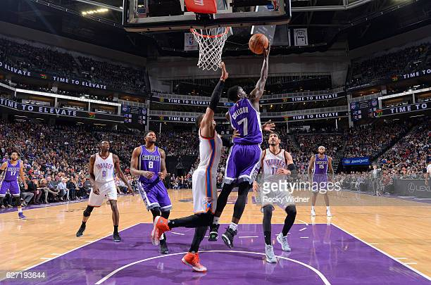 Darren Collison of the Sacramento Kings shoots a layup against Russell Westbrook of the Oklahoma City Thunder on November 23 2016 at Golden 1 Center...