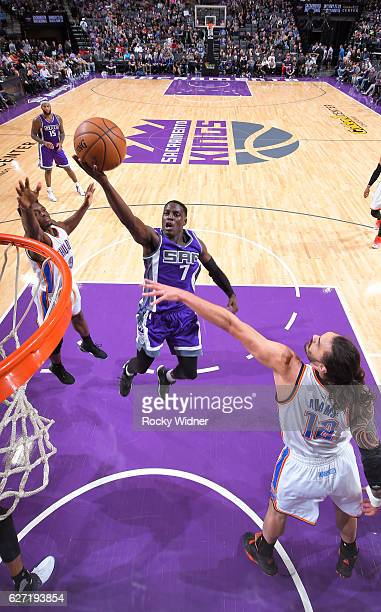 Darren Collison of the Sacramento Kings shoots a layup against Steven Adams of the Oklahoma City Thunder on November 23 2016 at Golden 1 Center in...