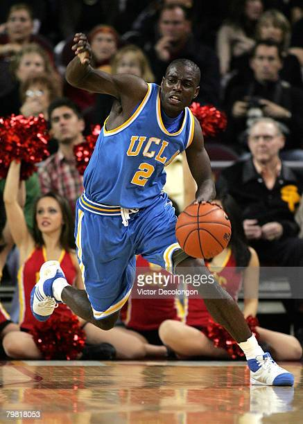 Darren Collison of the UCLA Bruins dribbles the ball on the fast break in the second half against the USC Trojans during their Pac-10 Conference game...