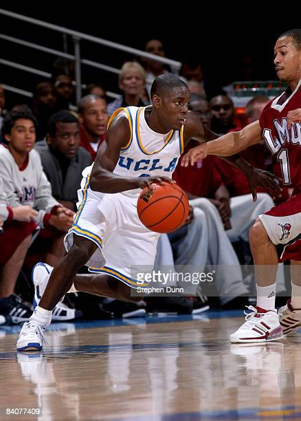 Darren Collison of the UCLA Bruins drives against Corey Counts of the Loyola Marymount Lions at Pauley Pavilion December 17 2008 in Westwood...