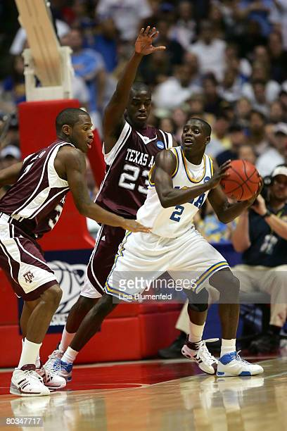 Darren Collison of the UCLA Bruins moves against the defense of Josh Carter and Derrick Roland of the Texas AM Aggies during the West Region second...
