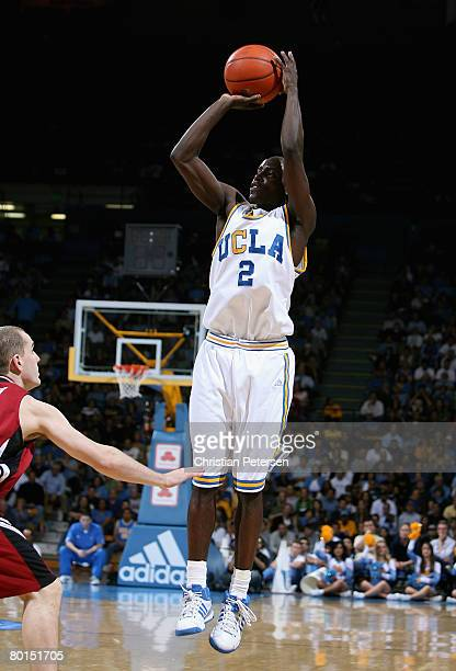 Darren Collison of the UCLA Bruins shoots a three point shot against the Stanford Cardinal during the college basketball game at Pauley Pavilion on...