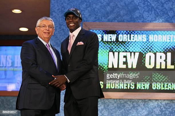 Darren Collison shakes hands with NBA Commissioner David Stern after being selected number twenty one by the New Orleans Hornets during the 2009 NBA...