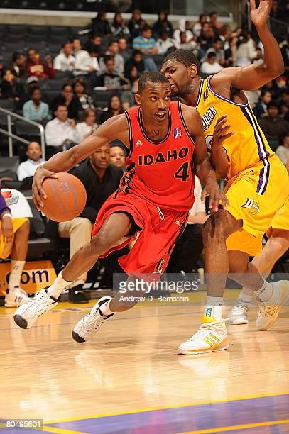 Darren Cooper of the Los Angeles DFenders attempts to block Mike Taylor the Idaho Stampede at Staples Center on April 2 2008 in Los Angeles...
