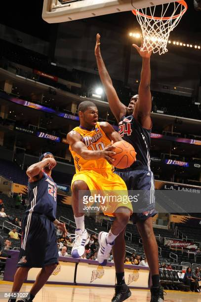 Darren Cooper of the Los Angeles DFenders makes a pass against the defense of Marcus Campbell of the Anaheim Arsenal at Staples Center on January 25...