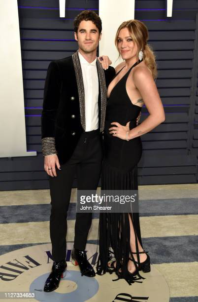 Darren Criss and Mia Swier attend the 2019 Vanity Fair Oscar Party hosted by Radhika Jones at Wallis Annenberg Center for the Performing Arts on...