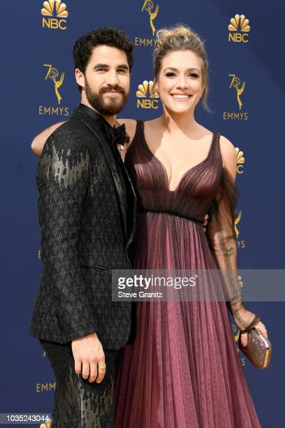 Darren Criss and Mia Swier attend the 70th Emmy Awards at Microsoft Theater on September 17 2018 in Los Angeles California