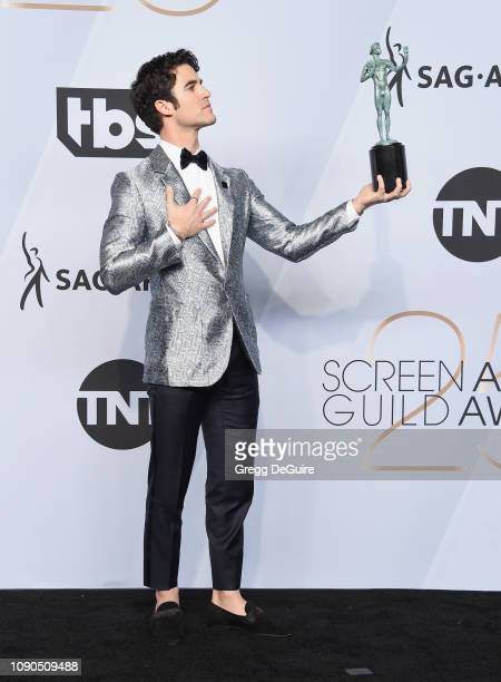 Darren Criss poses in the press room with award for Outstanding Performance by a Male Actor in a Miniseries or Television Movie in 'The Assassination...