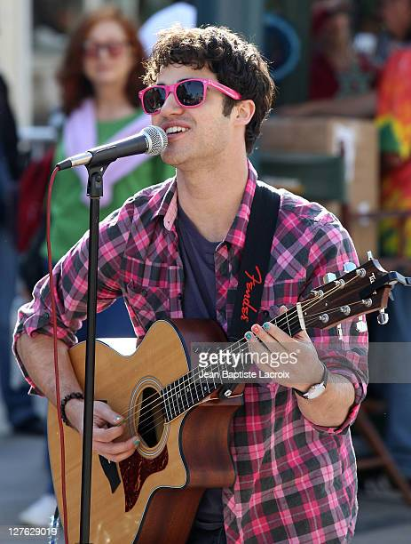 Darren Criss takes part in a pop up performance for Cambio's 'On the Spot' series at 3rd Street Promenade on April 20 2011 in Santa Monica California