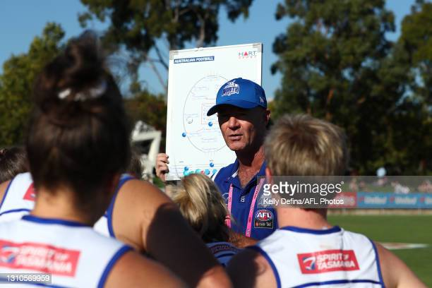 Darren Crocker coach of the Kangaroos speaks to players during the AFLW Finals Series match between the Collingwood Magpies and the North Melbourne...