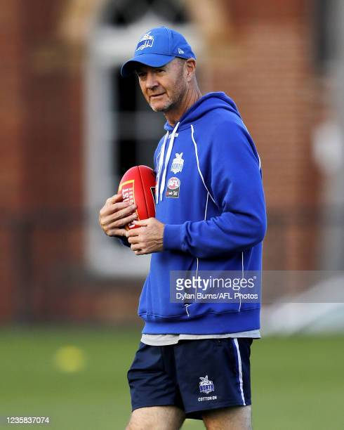 Darren Crocker, Head Coach of the Kangaroos looks on during the North Melbourne training session at Arden Street Oval on October 12, 2021 in...