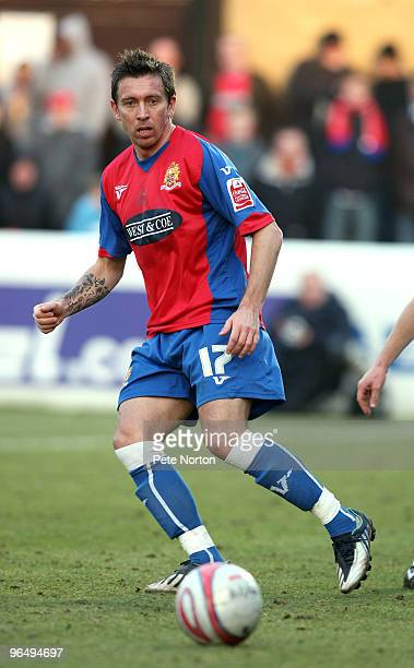 Darren Currie of Dagenham Redbridge in action during the Coca Cola League Two Match between Dagenham Redbridge and Northampton Town at the London...
