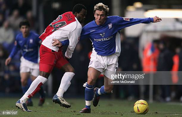 Darren Currie of Ipswich holds off Stern John of Coventry during the Coca Cola Championship match between Ipswich Town and Coventry City at Portman...