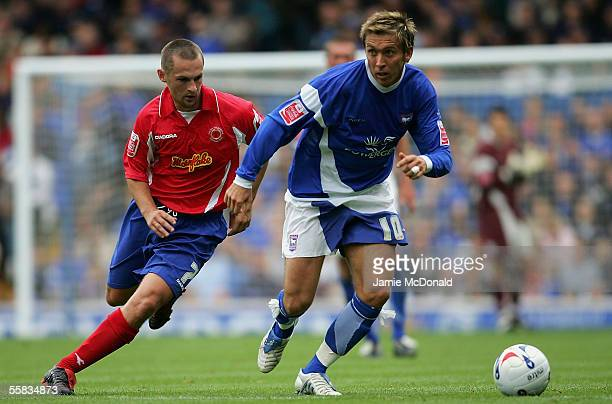Darren Currie of Ipswich is tackled by Kenny Lunt of Crewe during the CocaCola Championship match between Ipswich Town and Crewe Alexandra at Portman...