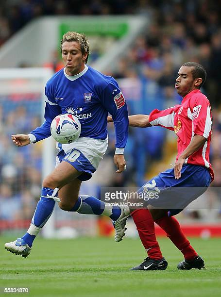Darren Currie of Ipswich is tackled by Paul Bignot of Crewe during the CocaCola Championship match between Ipswich Town and Crewe Alexandra at...