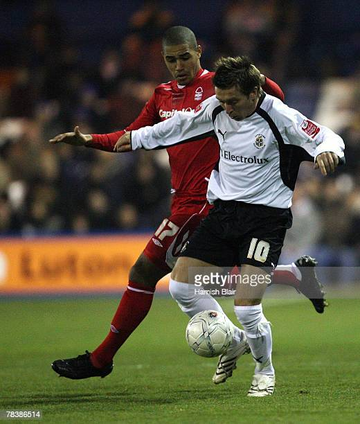 Darren Currie of Luton contests with Lewis McGugan of Nottingham during the FA Cup Sponsored by eon Second Round Replay match between Luton Town and...