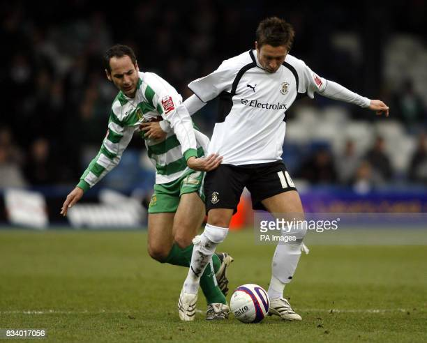 Darren Currie of Luton Town is challenged by Matt Rose of Yeovil Town during the CocaCola Football League One match at Kenilworth Road Luton