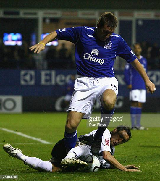 Darren Currie of Luton Town tackles Alan Stubbs of Everton during the Carling Cup Fourth Round match between Luton Town and Everton at Kenilworth...