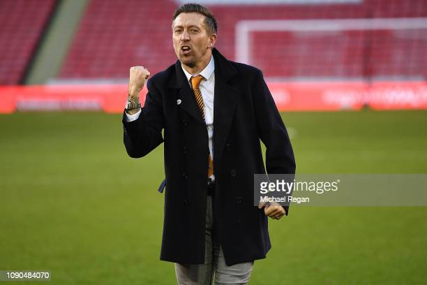 Darren Currie the caretaker manager of Barnet celebrates with the travelling supporters after his sides 10 victory during the FA Cup Third Round...