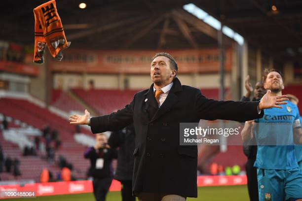 Darren Currie the caretaker manager of Barnet leads the celebrations following his sides 10 victory during the FA Cup Third Round match between...