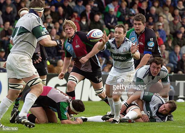 Darren Edwards of London Irish releases the ball to his team mate Ryan Strudwick during the Zurich Premiership match between NEC Harlequins and...
