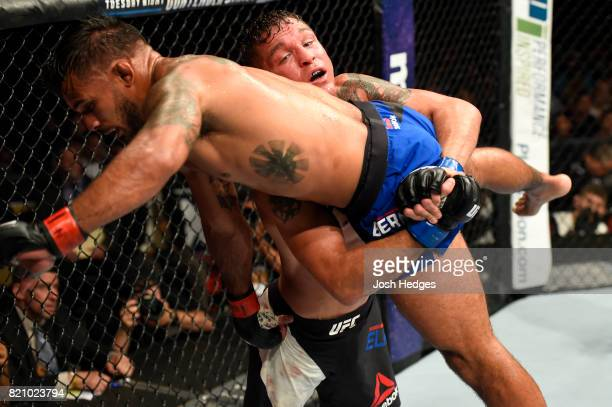 Darren Elkins attempts to take down Dennis Bermudez in their featherweight bout during the UFC Fight Night event inside the Nassau Veterans Memorial...