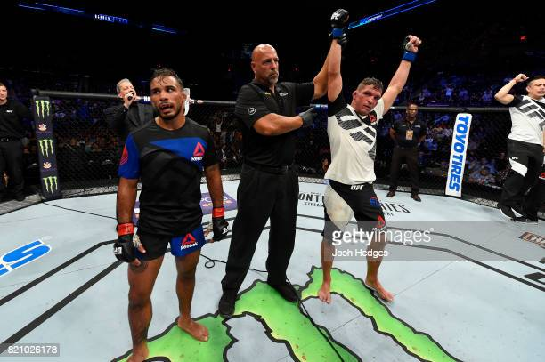 Darren Elkins celebrates after defeating Dennis Bermudez in their featherweight bout during the UFC Fight Night event inside the Nassau Veterans...