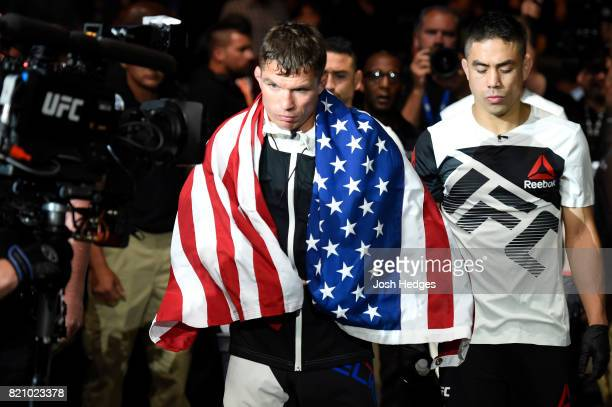Darren Elkins enters the arena prior to facing Dennis Bermudez in their featherweight bout during the UFC Fight Night event inside the Nassau...