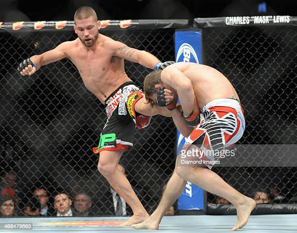 Darren Elkins grabs the leg of Jeremy Stephens during a featherweight bout during UFC on Fox 10 Henderson v Thomson at United Center in Chicago...