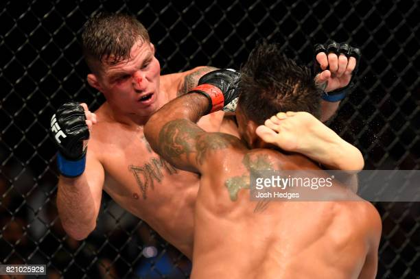 Darren Elkins kicks Dennis Bermudez in their featherweight bout during the UFC Fight Night event inside the Nassau Veterans Memorial Coliseum on July...