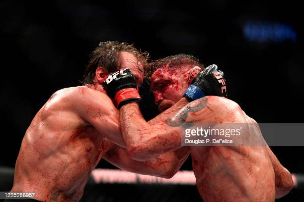 Darren Elkins of the United States fights Nate Landwehr of the United States in their Featherweight bout during UFC Fight Night at VyStar Veterans...