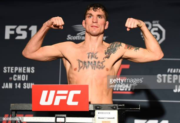 Darren Elkins poses on the scale during the UFC Fight Night weighin on January 13 2018 in St Louis Missouri