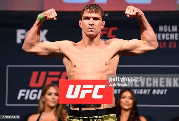 Darren Elkins poses on the scale during the UFC weighin at the United Center on July 22 2016 in Chicago Illinois