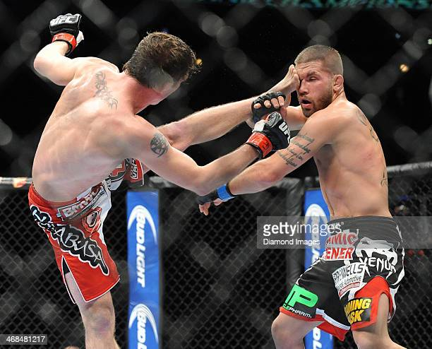 Darren Elkins throws a kick at Jeremy Stephens during a featherweight bout during UFC on Fox 10 Henderson v Thomson at United Center in Chicago...