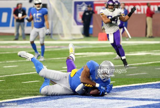 Darren Fells of the Detroit Lions appears to score a touchdown that was later overturned on a review during the third quarter against the Minnesota...