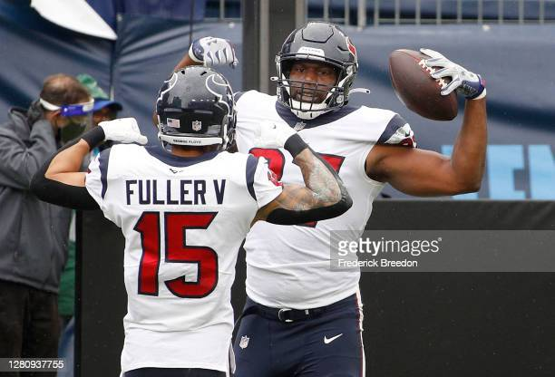 Darren Fells of the Houston Texans celebrates with Will Fuller V after Fells scored a touchdown in the second quarter against the Tennessee Titans at...