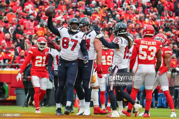 Darren Fells of the Houston Texans is congratulated by his teammates after a touchdown reception against the Kansas City Chiefs during the first...