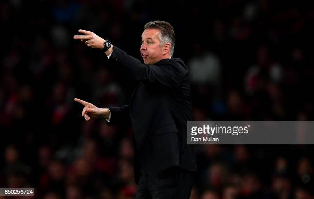 Darren Ferguson manager of Doncaster Rovers signals during the Carabao Cup Third Round match between Arsenal and Doncaster Rovers at Emirates Stadium...