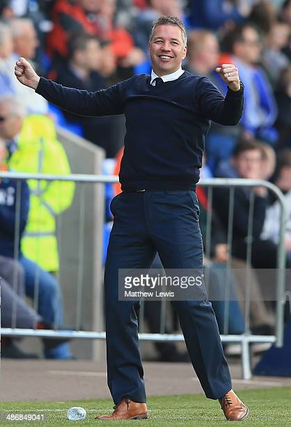 Darren Ferguson manager of Peterborough United celebrates his teams fourth goal during the Sky Bet League One match between Shrewsbury Town and...