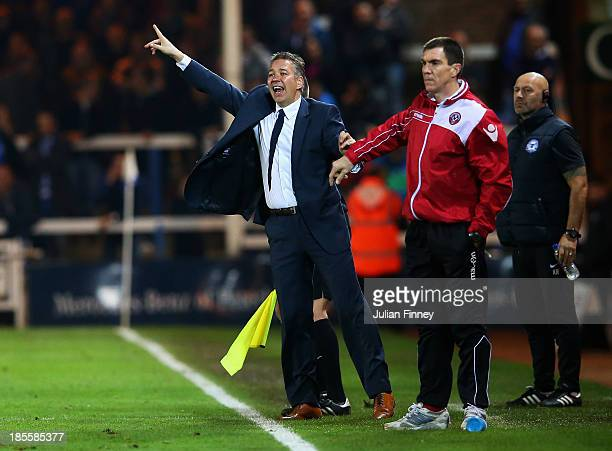 Darren Ferguson manager of Peterborough United shouts intructions as Chris Morgan caretaker manager of Sheffield United looks on during the Sky Bet...
